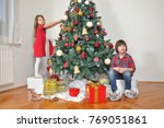 girl and boy decorate a... | Shutterstock . vector #769051861
