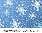 white snowflakes on a blue... | Shutterstock . vector #769052767