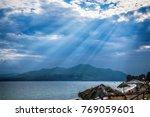 sun rays break through the... | Shutterstock . vector #769059601