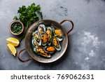 shellfish mussels clams in... | Shutterstock . vector #769062631