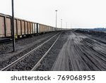 piles of coal next to a train... | Shutterstock . vector #769068955