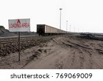 piles of coal next to a train... | Shutterstock . vector #769069009
