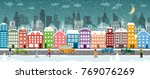 snow covered city with houses ... | Shutterstock .eps vector #769076269