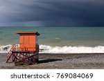 orange lifeguard hut on the...
