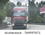 truck on the road under the... | Shutterstock . vector #769097671