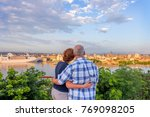 a gray haired man and a red... | Shutterstock . vector #769098205