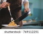 chef serves spaghetti carbonara ...   Shutterstock . vector #769112251