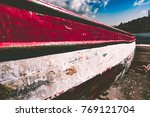 old aged wooden boat pulled... | Shutterstock . vector #769121704