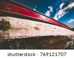 old aged wooden boat pulled... | Shutterstock . vector #769121707