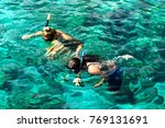 tourists are engaged in...   Shutterstock . vector #769131691