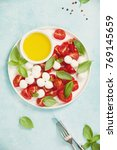 caprese salad with basil and... | Shutterstock . vector #769145659