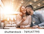 cheerful couple in cafe having... | Shutterstock . vector #769147795