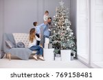 family decorating a christmas... | Shutterstock . vector #769158481