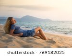 young woman in blue t shirt and ... | Shutterstock . vector #769182025