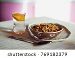 Small photo of Healthy Breakfast of Champions. Muesli , a glass of water with a slice of orange. Ceramic handmade