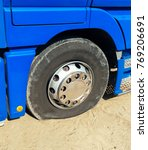 Small photo of Heavy truck flat tire.