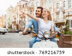 young couple on scooter travel... | Shutterstock . vector #769216759