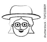 male face with hat and glasses... | Shutterstock .eps vector #769220809