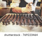 chef chocolate making | Shutterstock . vector #769223464