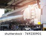 oil truck releasing fuel oil... | Shutterstock . vector #769230901