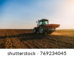 farmer fertilizing arable land... | Shutterstock . vector #769234045