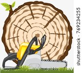 sawed down tree and instrument... | Shutterstock .eps vector #769234255