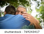 adult son hugging his senior dad | Shutterstock . vector #769243417