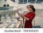 female customer choosing... | Shutterstock . vector #769244191