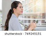 beautiful girl using looking... | Shutterstock . vector #769245151