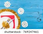 a knife and fork in white plate ... | Shutterstock . vector #769247461