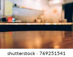 wood table top with blur of... | Shutterstock . vector #769251541