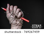 hand with red pencil tied with... | Shutterstock . vector #769267459