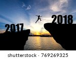 man jumping from 2017 to 2018 | Shutterstock . vector #769269325