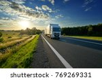 white delivery truck driving on ... | Shutterstock . vector #769269331
