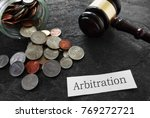 coins and legal gavel with... | Shutterstock . vector #769272721