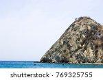 isla frente a playa blanca ... | Shutterstock . vector #769325755