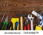 tools on wood planks . top view | Shutterstock . vector #769348879