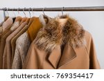 row of women leather coat and... | Shutterstock . vector #769354417