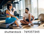 attractive young fitness couple ... | Shutterstock . vector #769357345