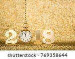 new year 2018 on gold background   Shutterstock . vector #769358644