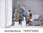 family decorating a christmas... | Shutterstock . vector #769372405