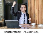 great job  cheerful young asian ... | Shutterstock . vector #769384321