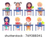 set of schoolchildren sitting... | Shutterstock .eps vector #769388341