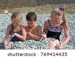 siblings have fun time on the... | Shutterstock . vector #769414435