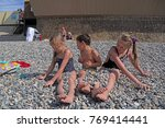 siblings have fun time on the... | Shutterstock . vector #769414441