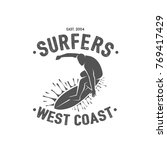 surfing logo. ride the wave.... | Shutterstock .eps vector #769417429