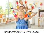 children and teacher with hands ... | Shutterstock . vector #769435651