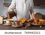 breakfast with black coffee and ... | Shutterstock . vector #769442311
