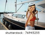 beautiful girl posing with a... | Shutterstock . vector #76945255