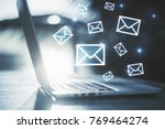 side view of laptop with e mail ... | Shutterstock . vector #769464274